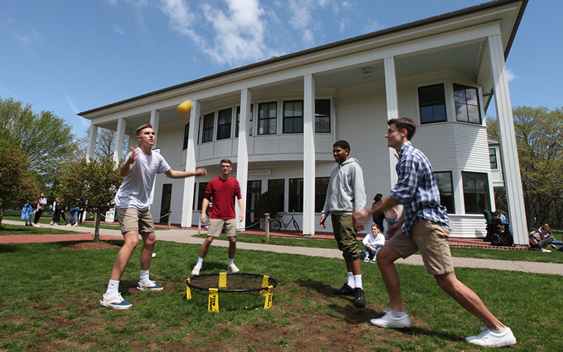 Rocky Hill Upper School students playing Spikeball during a club outdoors in front of Flynn