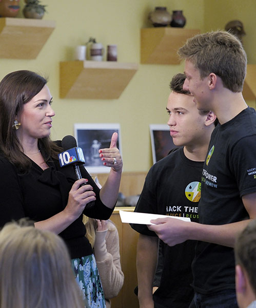 Rock Hill students being interviewed on WJAR Channel 10 News during a hackathon