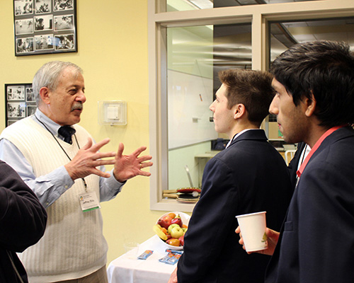 Rocky Hill alumnus mentoring students at a function